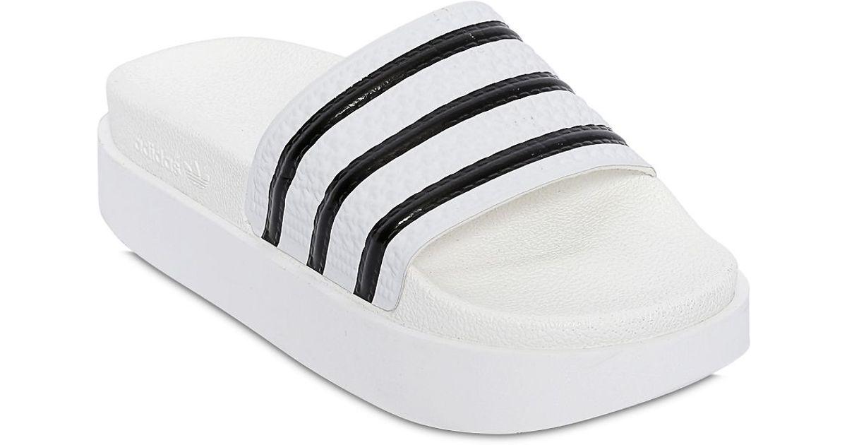 1057031073d1 Lyst - adidas Originals Adilette Bold Rubber Slides in White