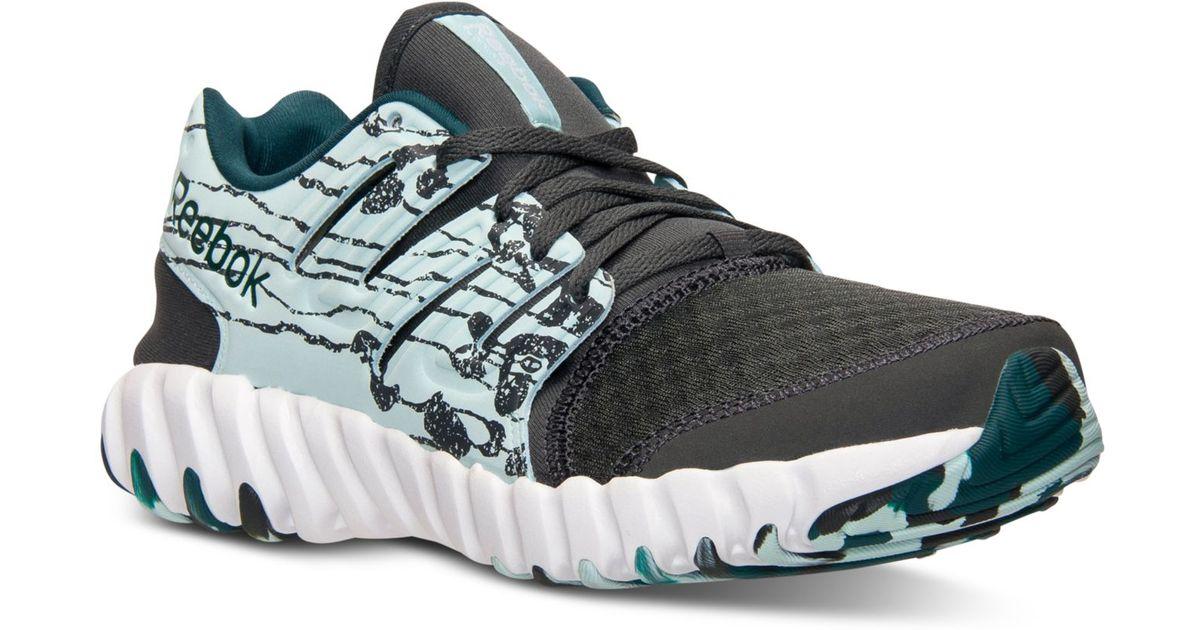 20c6213c71ed Lyst - Reebok Women s Twistform Running Sneakers From Finish Line in Blue