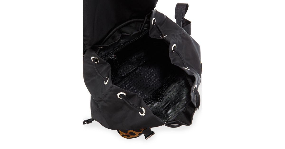 3b22a4939d4e82 ... australia lyst prada tessuto leopard print trim nylon backpack in black  77f81 b2f78