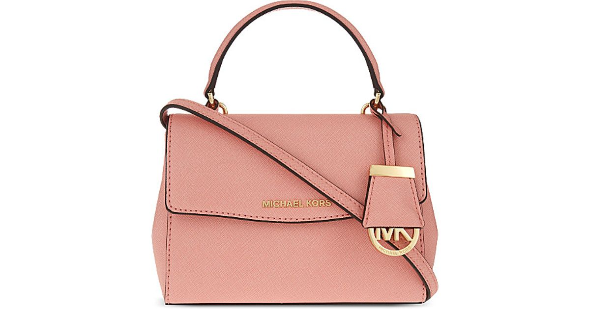 edcb3293f37aa6 ... where to buy michael michael kors ava extra small saffiano leather  cross body bag in pink ...