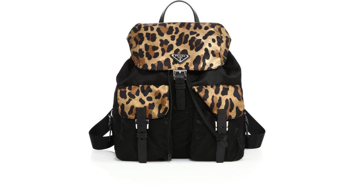 05bdda5a1b06 ... ireland lyst prada leopard print nylon backpack in black 9092a 686f9