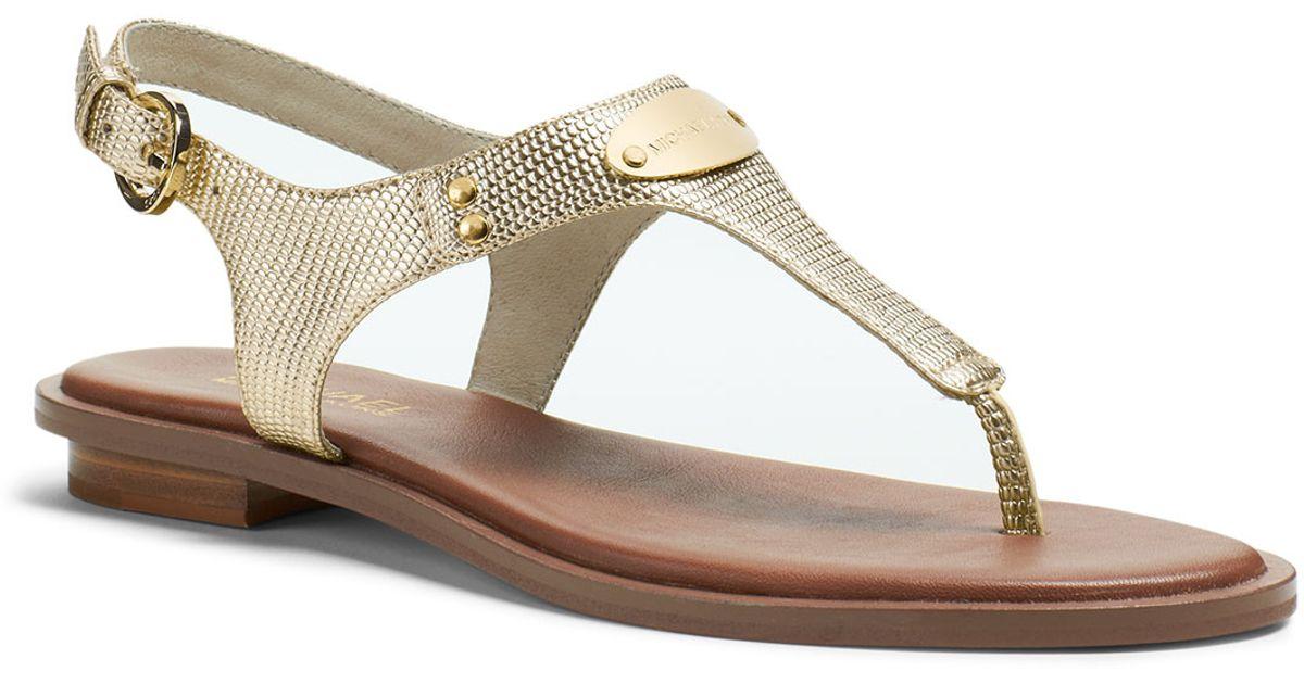 15607308e13c Lyst - Michael Kors Michael Plate Thong Sandal in Metallic