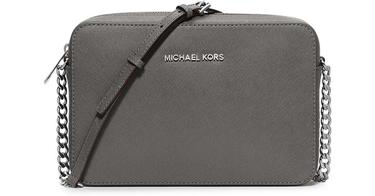 e157668bcd6 Lyst - MICHAEL Michael Kors Jet Set Travel Saffiano Cross-Body Bag in Gray