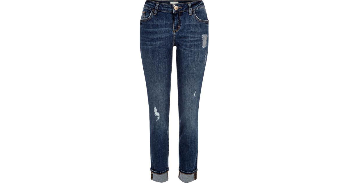 Dark wash distressed matilda skinny jeans