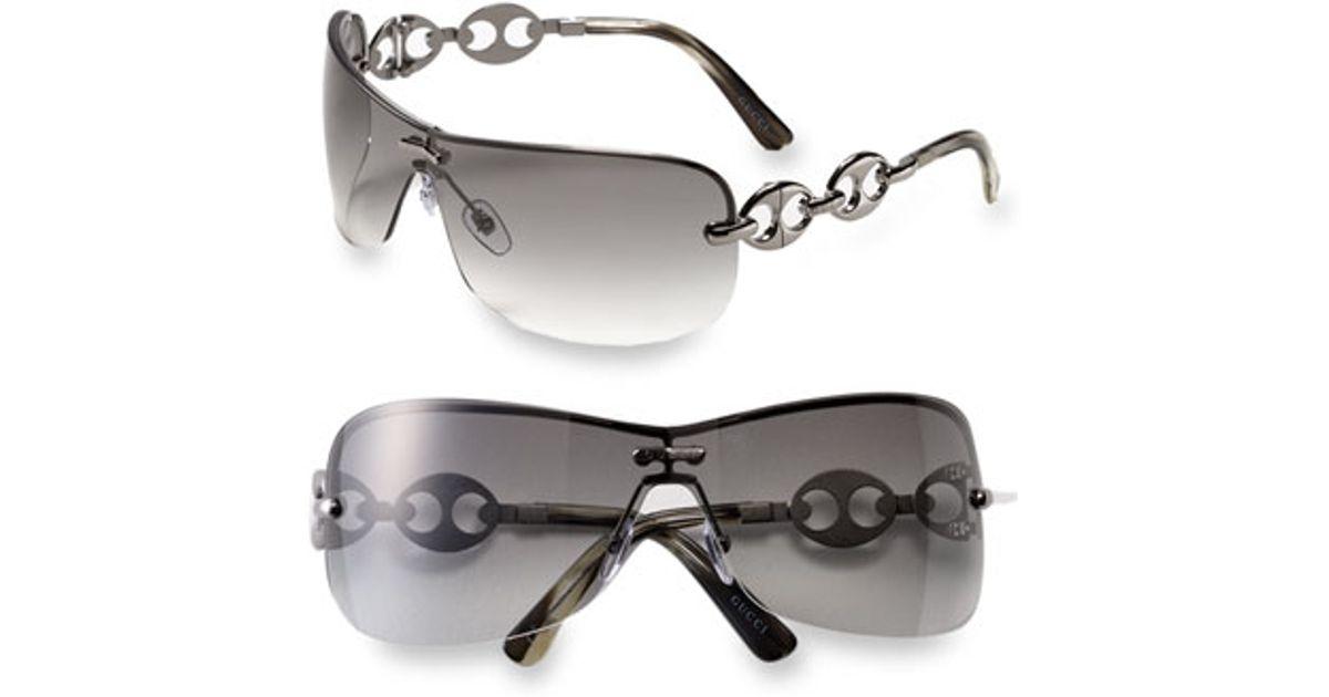 aea6cc87176 Lyst - Gucci Rimless Shield Sunglasses With Chain Detail - Gunmetal in  Metallic
