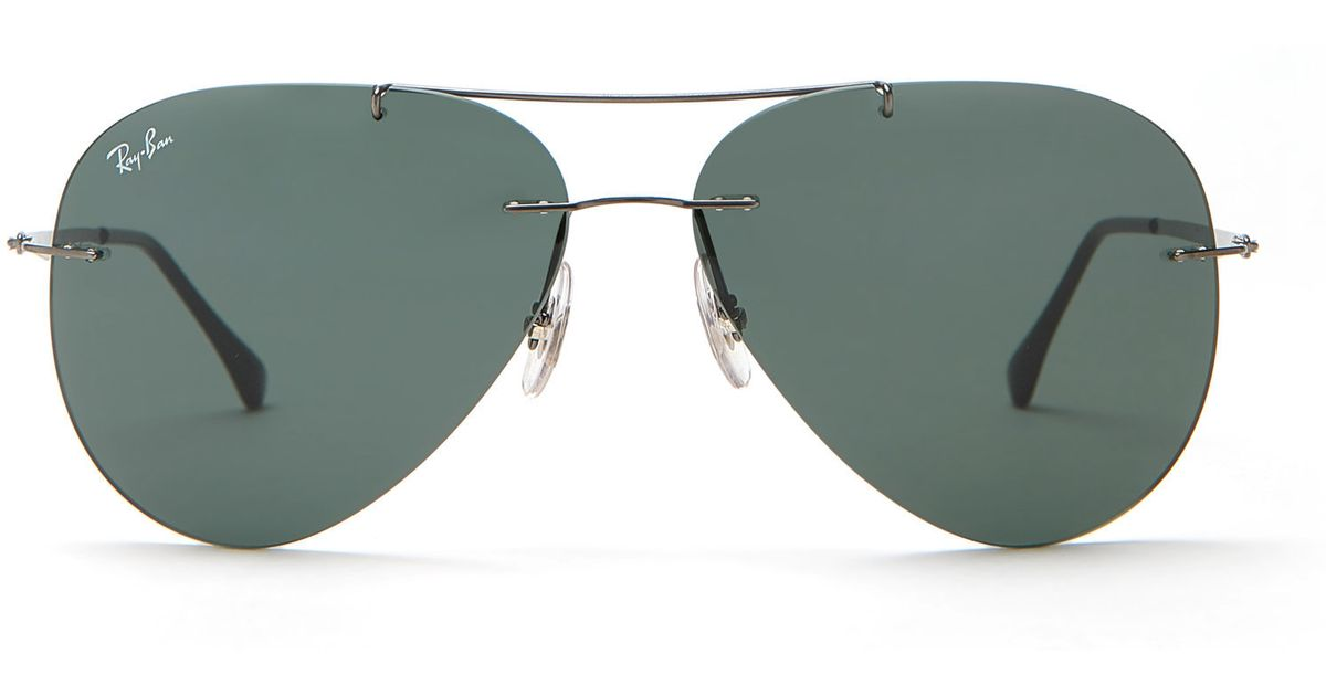 05fb5634951 Lyst - Ray-Ban Rb8055 Rimless Aviator Sunglasses in Metallic