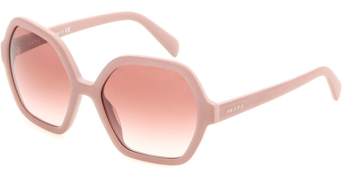 0e2a46bea916 Prada Sunglasses in Pink - Lyst