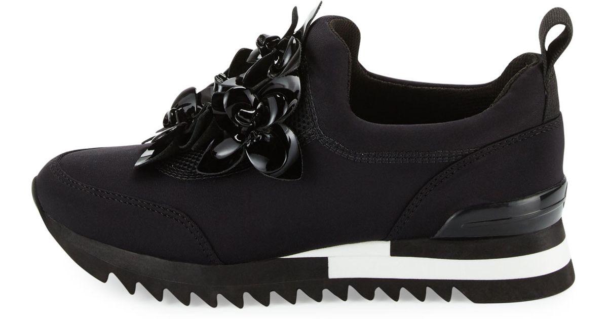 c03e01421dc5 Lyst - Tory Burch Blossom Neoprene Sneaker in Black