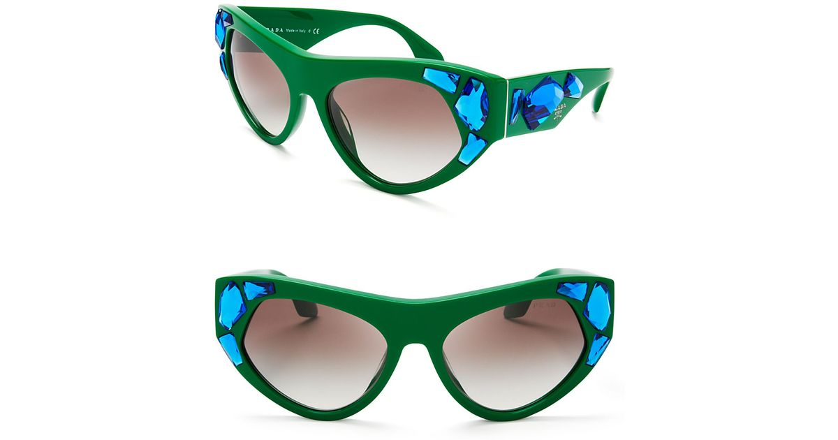 a5439c769ab8 ... discount lyst prada oversized crystal cat eye sunglasses in green 570fb  cc881