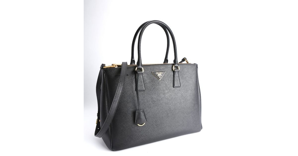 d9a180b472c0 ... nextprev. prevnext dc53d 13ff7 store lyst prada black saffiano leather  top handle bag in black d3252 06c2b ...
