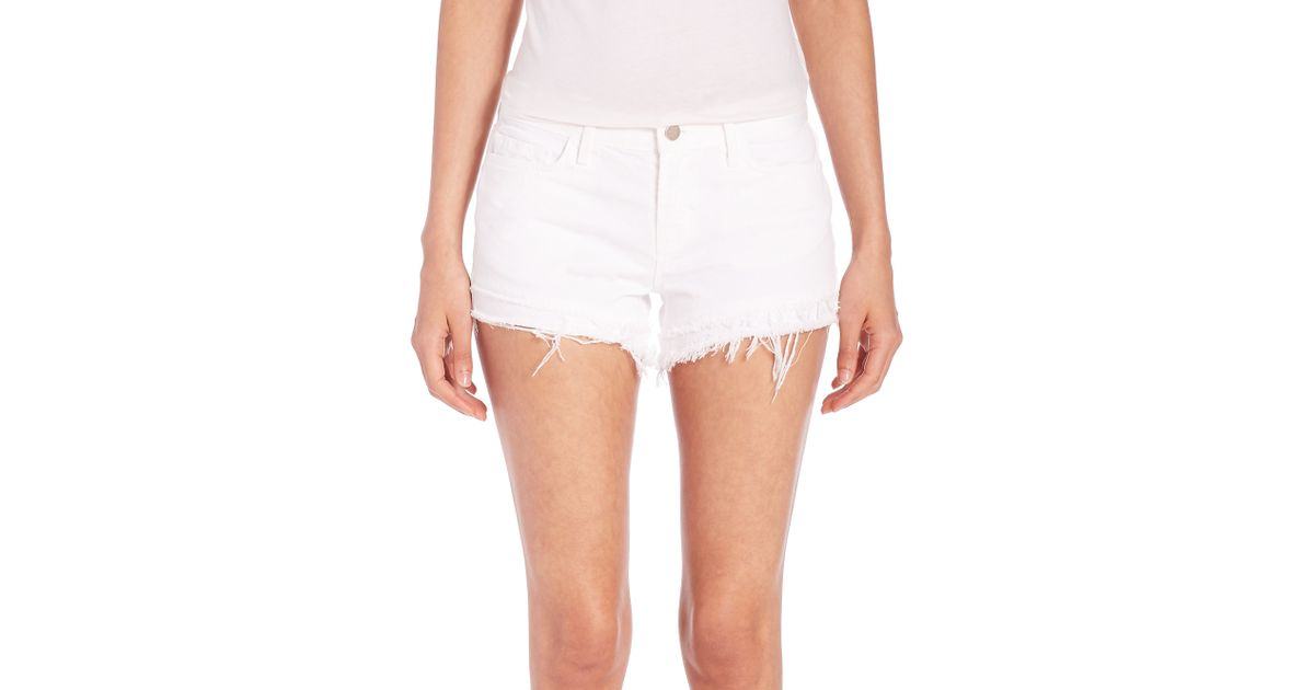 63c5071b7ea Lyst - J Brand Sachi Distressed Cut-off Denim Shorts in White