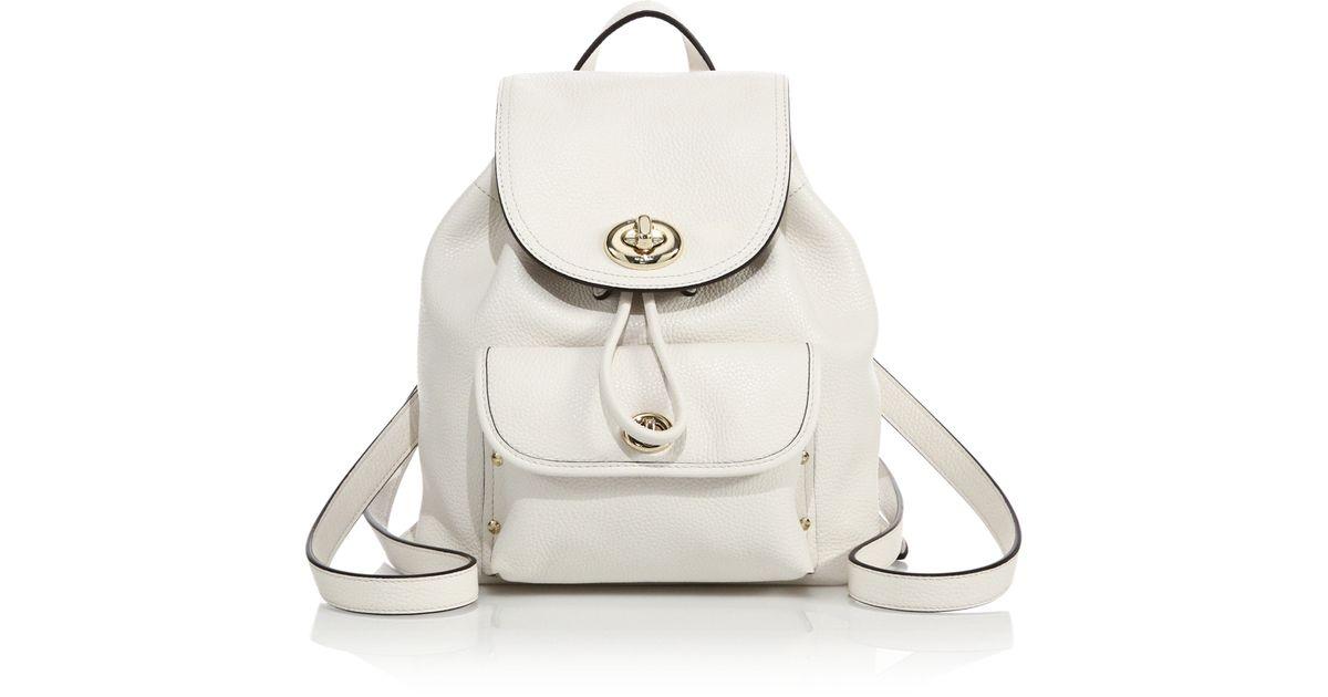 b2c67440b6ba Lyst - COACH Mini Leather Turnlock Backpack in White
