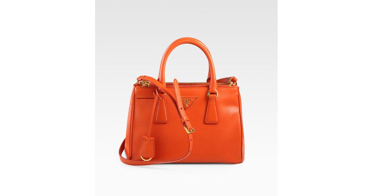 98d94d754bf1 new arrivals lyst prada saffiano lux small double zip tote in orange bc427  5ce0e