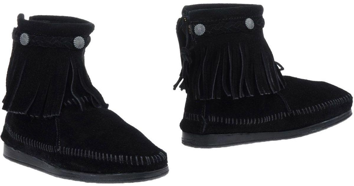 minnetonka ankle boots in black lyst