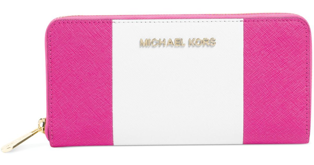 f9bfbb83e4da Lyst - Michael Kors Michael Jet Set Travel Center Stripe Zip Around  Continental Wallet in Pink