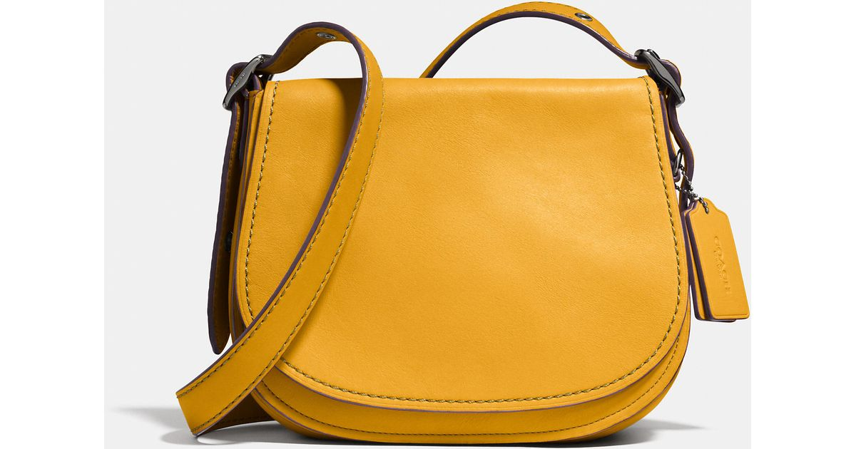 bc0300ec3e3 Lyst - COACH Saddle Bag 23 In Glovetanned Leather in Yellow