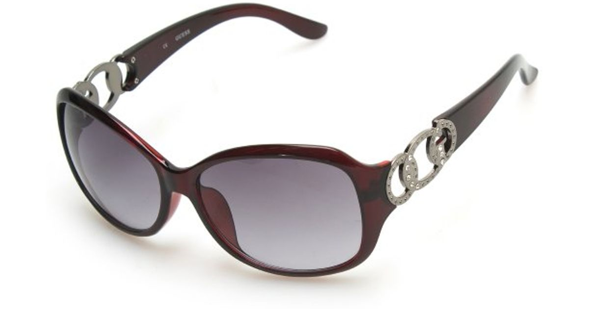 91167d008956 Lyst - Guess Round Frame Women s Sunglasses in Red