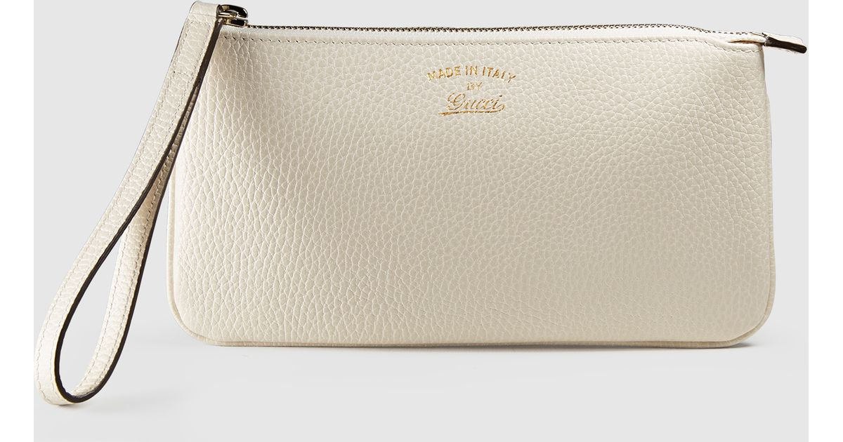9a8215221f6 Lyst - Gucci Swing Leather Wristlet in Natural