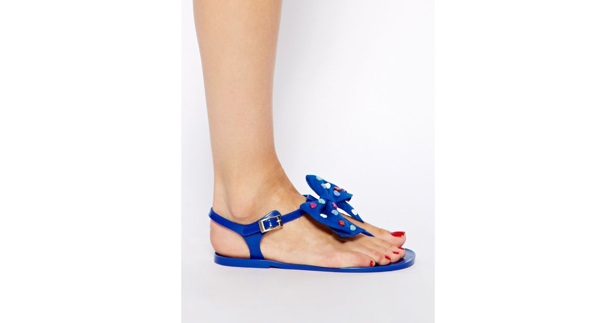 b5a8f50aad9d Lyst - Love Moschino Heart Bow Blue Jelly Flat Sandals in Blue