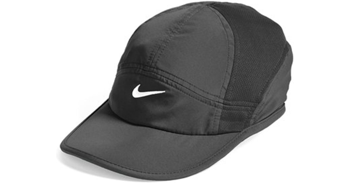 9032c7eafffbb ... inexpensive lyst nike featherlight 2.0 dri fit cap in black c62ac bd3a0  ...
