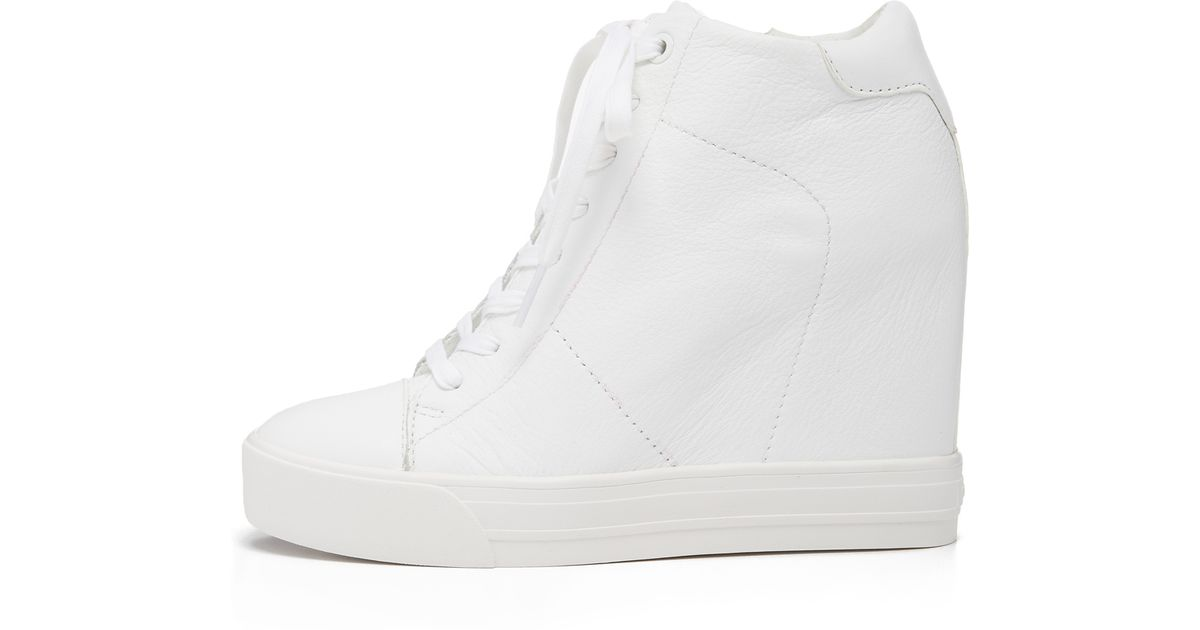 4503bf7c0bf Lyst - DKNY Ginnie Wedge Sneakers in White
