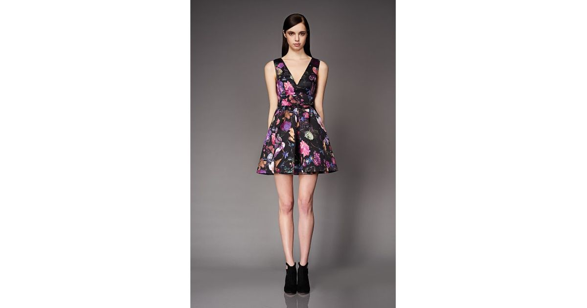 Lyst - Cynthia Rowley Printed Duchess Drop Waist Dress With Deep V Neckline  And Pleated Skirt in Black 702d2ac31