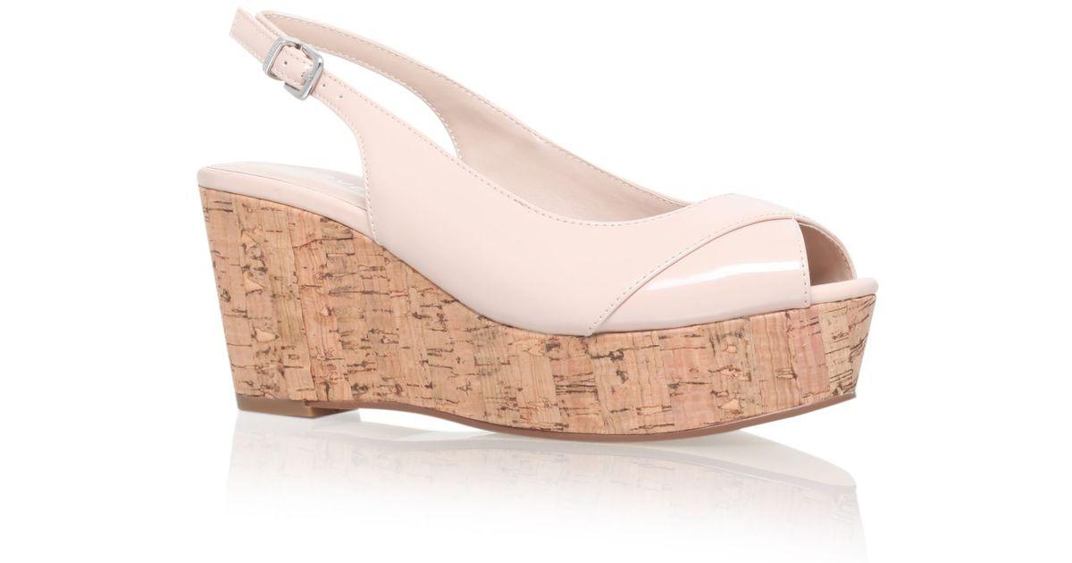 carvela kurt geiger klixy mid wedge sandals in lyst