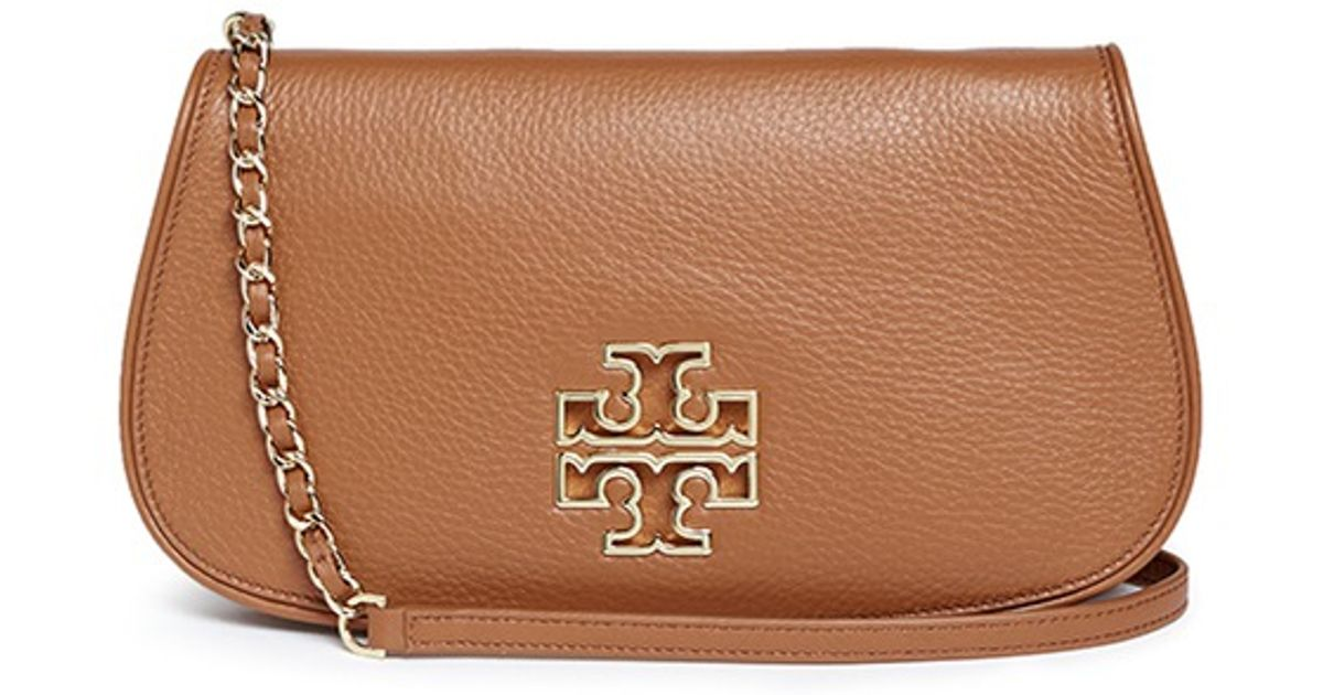 4007f9720d42 Lyst - Tory Burch  britten  Cutout Logo Pebbled Leather Chain Clutch in  Brown