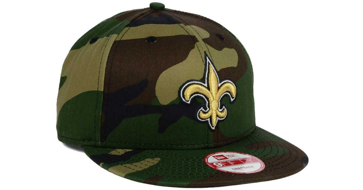 huge selection of 3ffe8 e313b KTZ New Orleans Saints Woodland Camo Team Color 9Fifty Snapback Cap in Green  for Men - Lyst