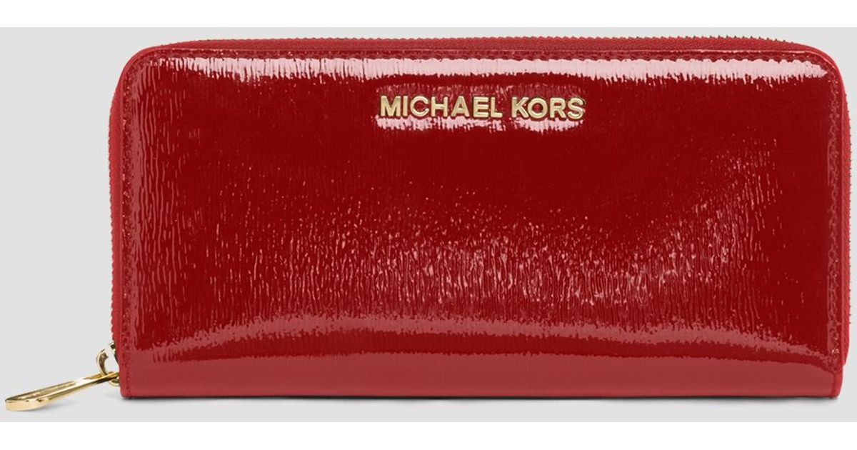 1c4b68f23cef Lyst - MICHAEL Michael Kors Wallet - Zip Around Patent Leather Continental  in Red