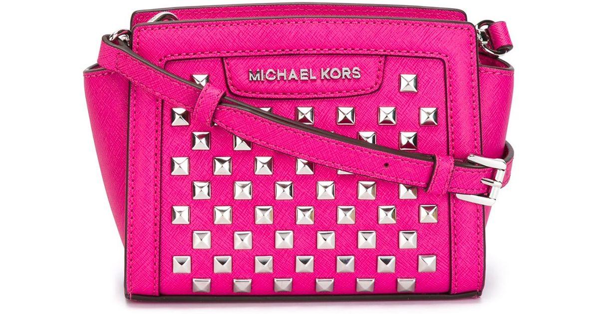 069b13f0b30b ... coupon lyst michael michael kors selma studded crossbody bag in pink  be6de ef46f