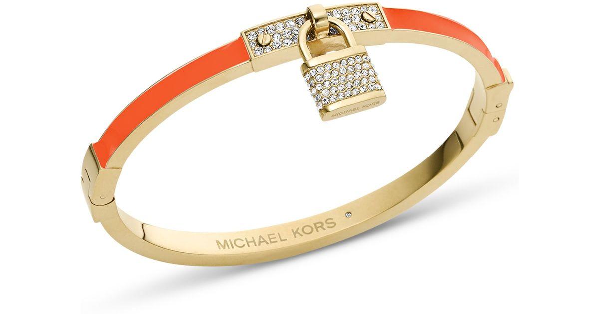 Lyst Michael Kors Goldtone Tangerine Pave Padlock Bangle Bracelet In Orange