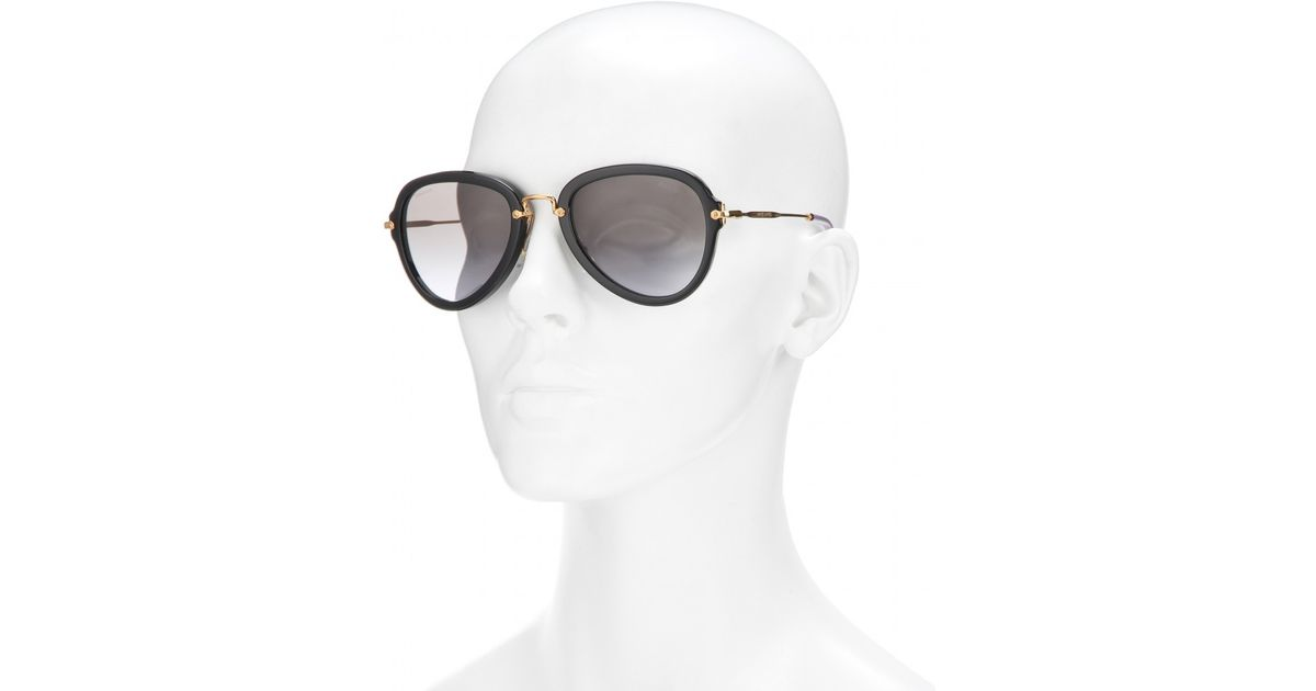 7b95c38c29e Lyst - Miu Miu Aviator Sunglasses in Black