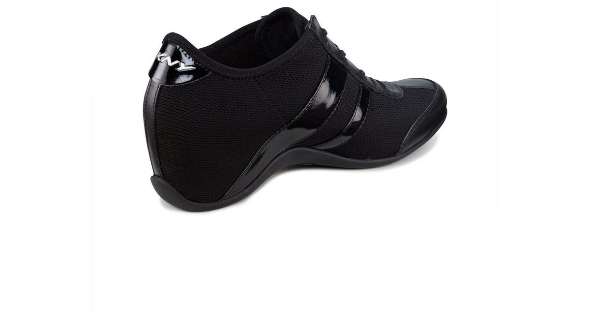 84ffc94f1d4 Lyst - DKNY Paige Wedge Sneaker in Black