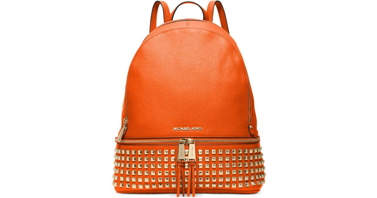 bf7b010750a8 Michael Kors Michael Rhea Zip Large Studded Backpack in Orange - Lyst