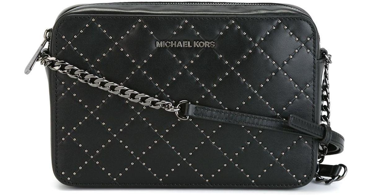 119836d5881f ... best lyst michael kors jet set travel micro stud bag in black 93bc8  e3e60