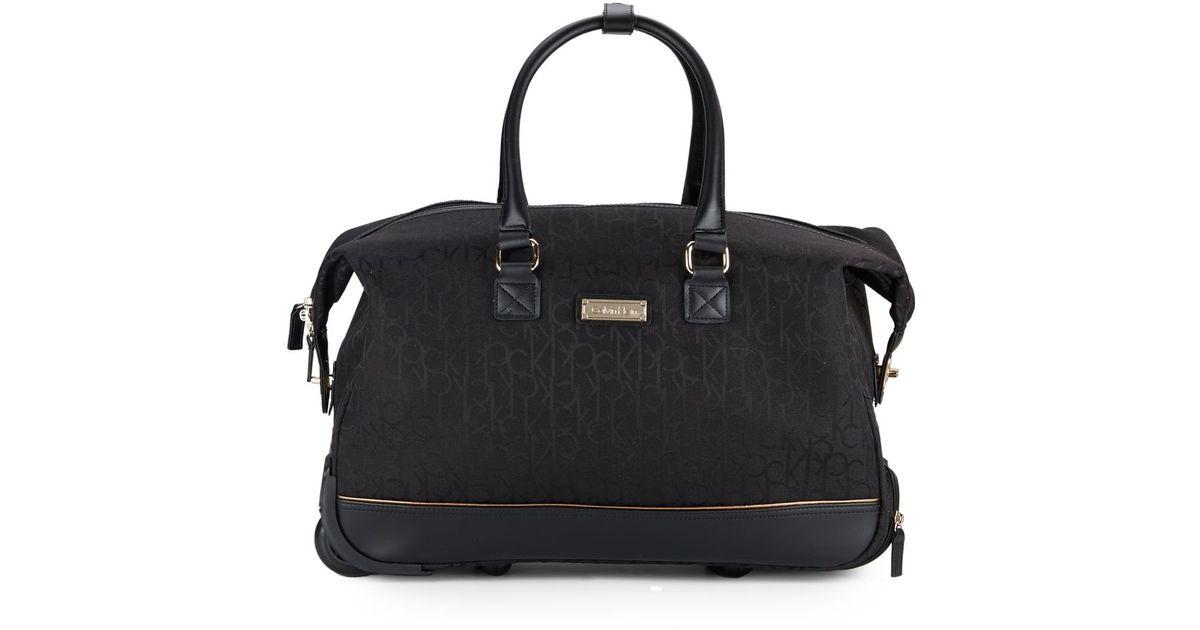 93cac3f2c Lyst - Calvin Klein Nolita Logo-embossed Carry-on Tote in Black for Men