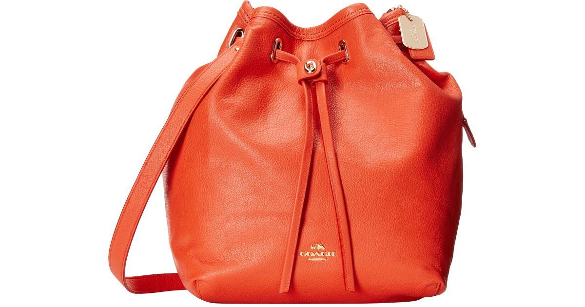 9acedc43da19 Lyst - COACH Matte Soft Grain Turnlock Tie Bucket Bag in Red
