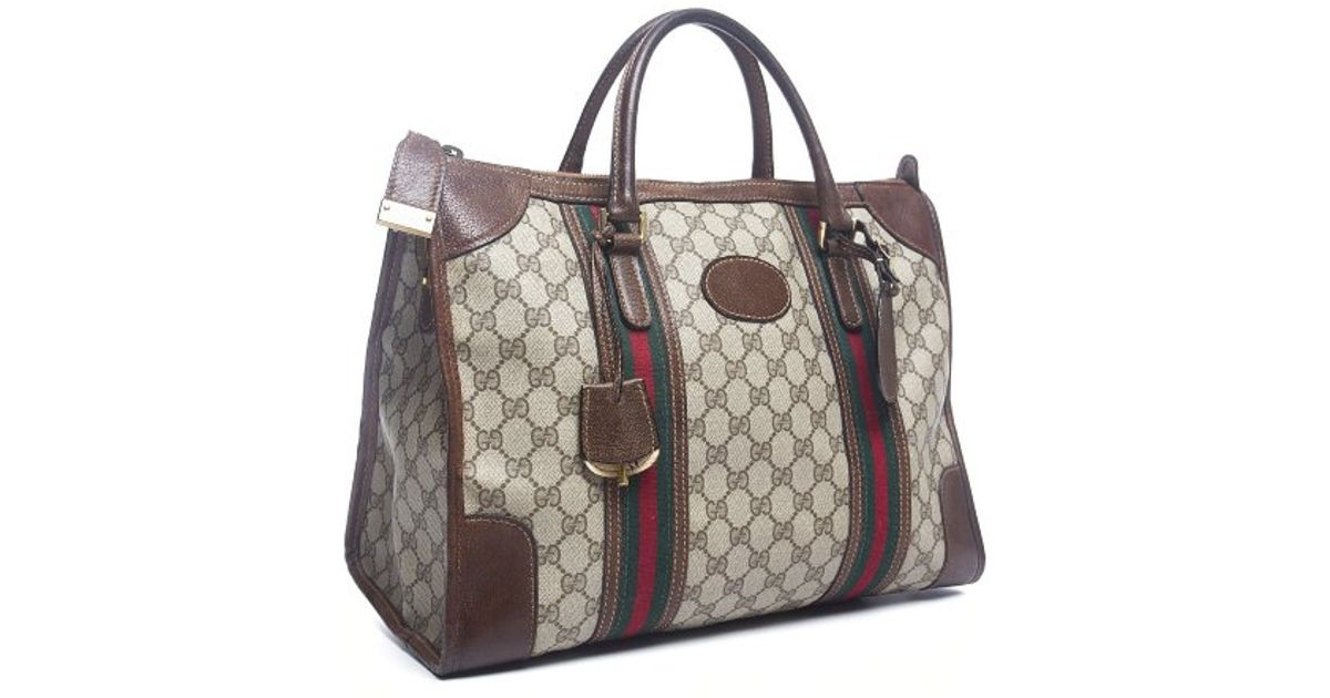 lyst gucci pre owned monogram canvas vintage travel bag in brown