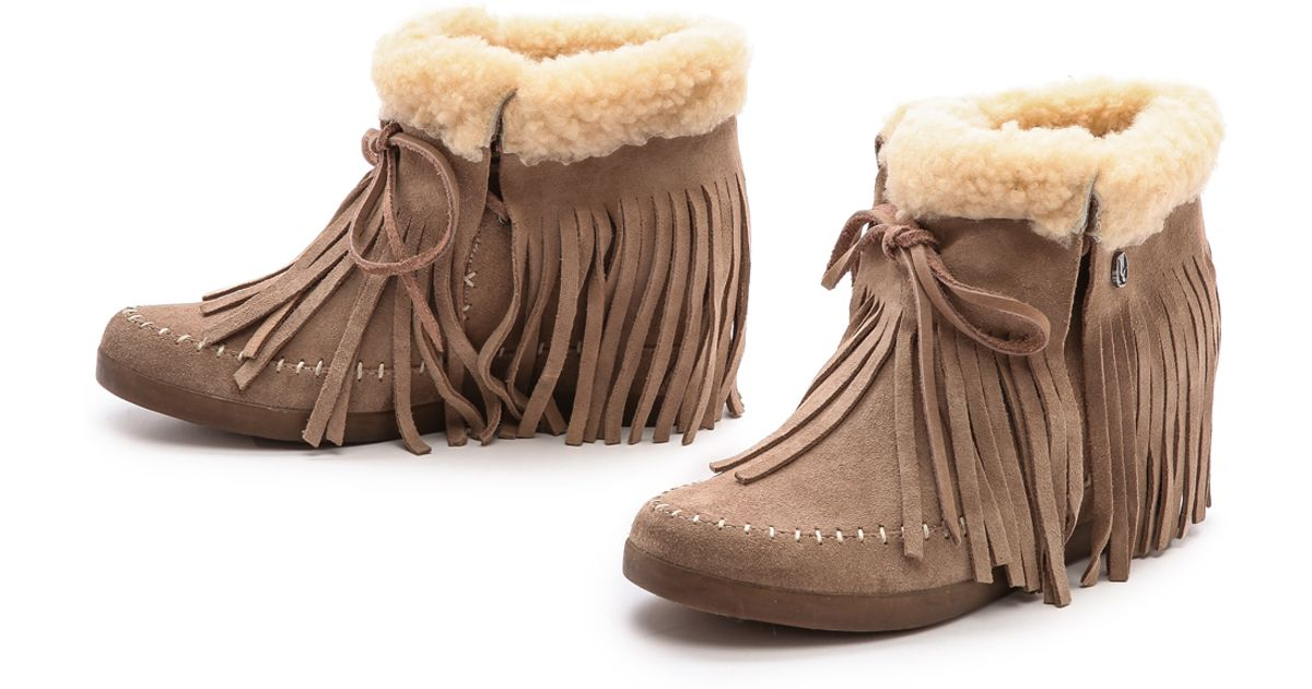 a2be71fc391 Lyst - Koolaburra Fringe Moccasin Wedge Booties - Stelle Blue in Natural