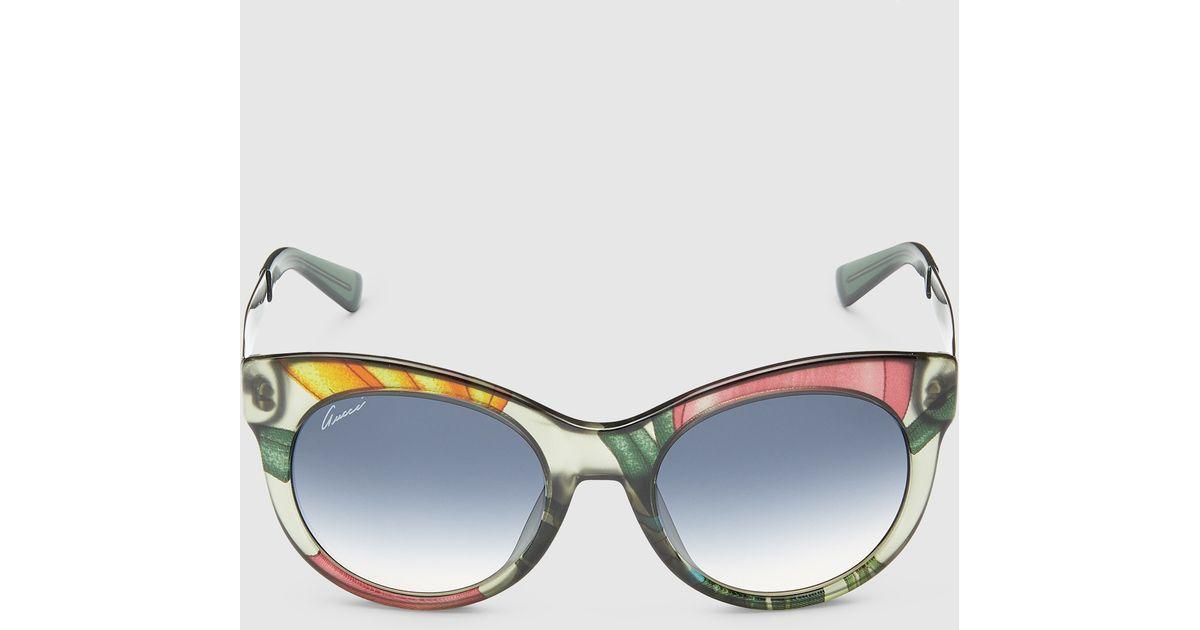 bf14e715f09 Lyst - Gucci Flora Silk Round-frame Sunglasses
