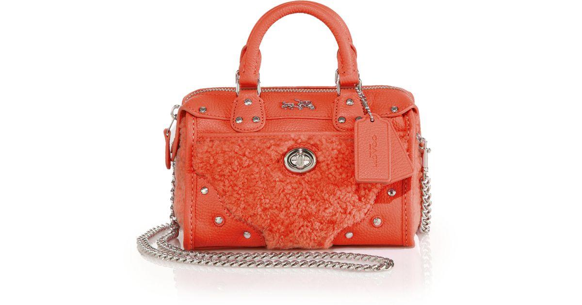 8f9fb8e86d7f ... release date lyst coach rhyder 18 shearling leather satchel in orange  83316 f107e