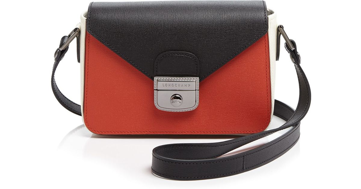 6648299dc803a Lyst - Longchamp Small Le Pliage Heritage Crossbody in Red