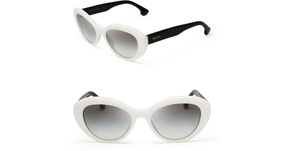 affa4017ddc9 Prada Cat Eye Sunglasses in White - Lyst