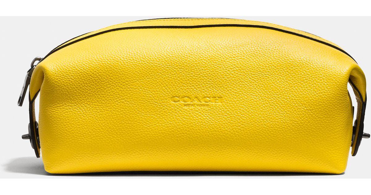 f5ac2ddd14 Lyst - COACH Dopp Kit In Refined Pebble Leather in Yellow for Men