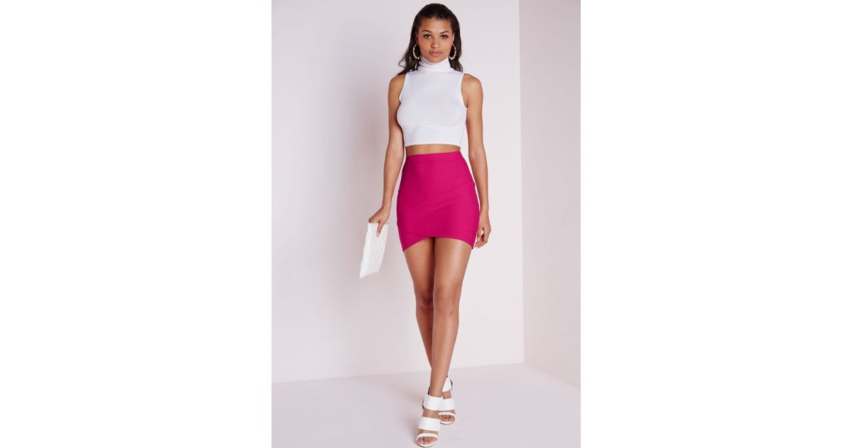 3ecc029b7f12 Missguided Bandage Asymmetric Hem Mini Skirt Pink in Pink - Lyst