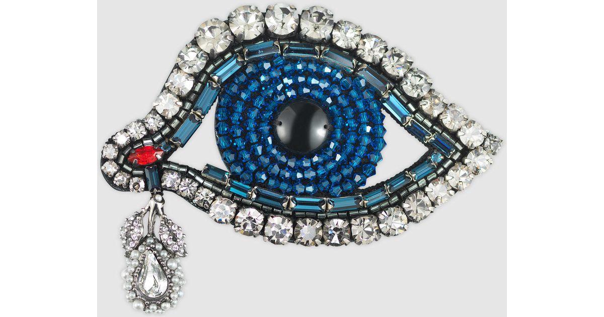 gucci-us-metal-eye-brooch-with-swarovski
