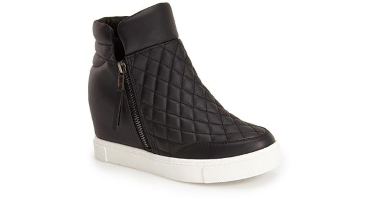 lyst steve madden linqs hidden wedge sneaker in black