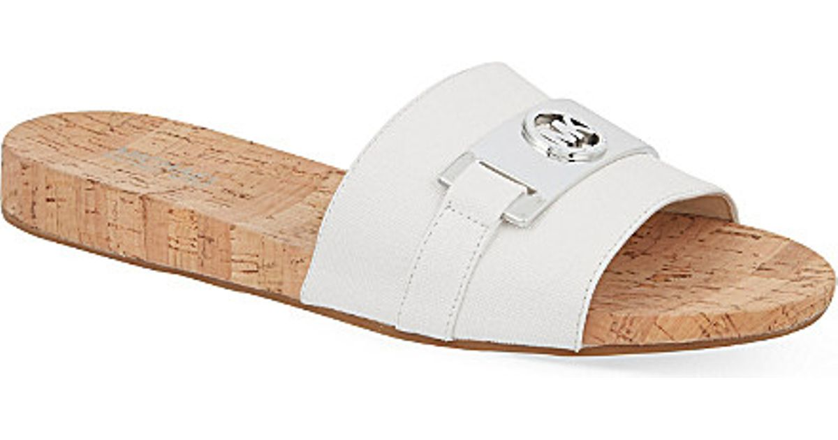 f7cc0eea2a2 Lyst - MICHAEL Michael Kors Warren Slide Sandals in White