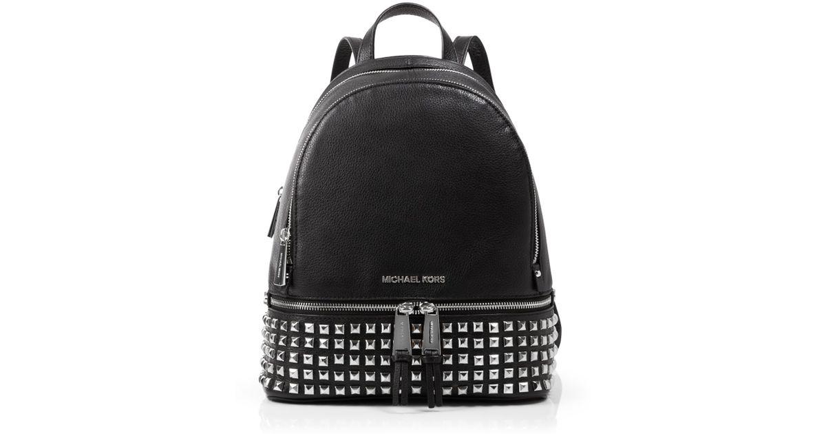 f23088ae1033 ... czech lyst michael michael kors small rhea zip studded backpack in  white 453bd 605fd